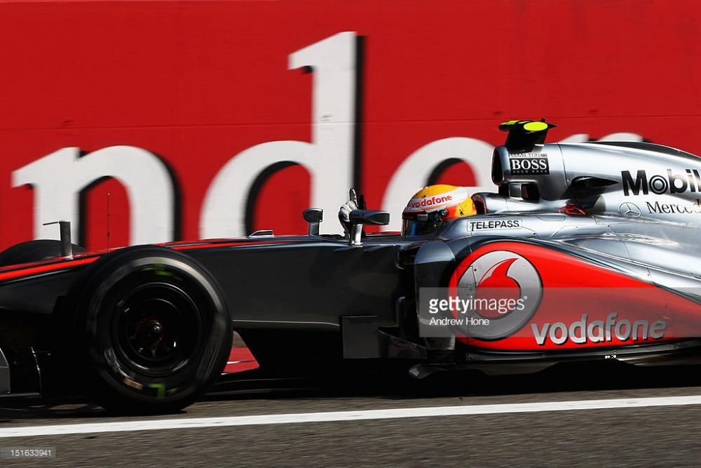 lewis-hamilton-of-great-britain-and-mclaren-celebrates-as-he-crosses-picture-id151633941.jpg